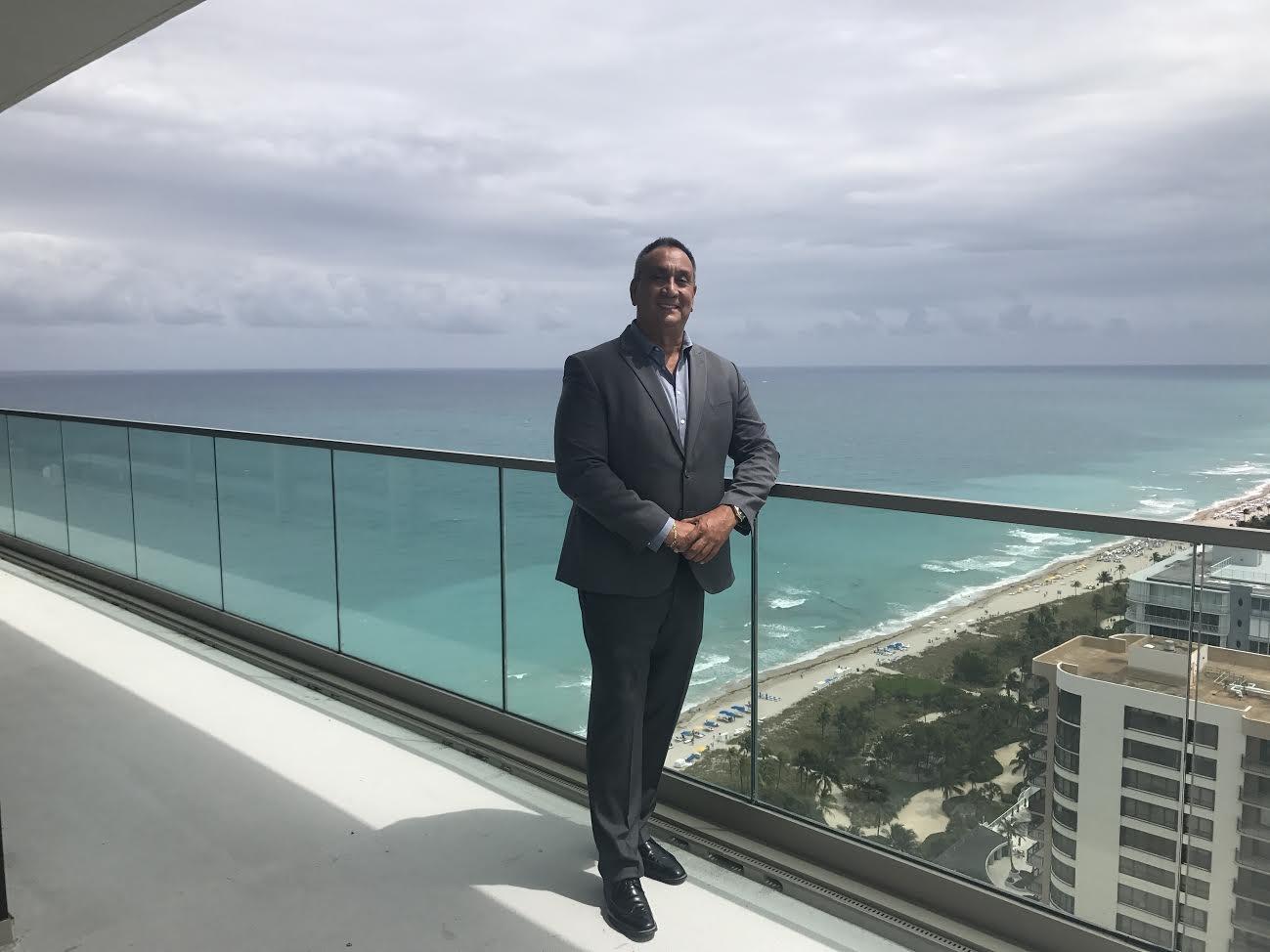 Raul Santidrian in the balcony of Oceana Bal Harbour Penthouse PH2701 S